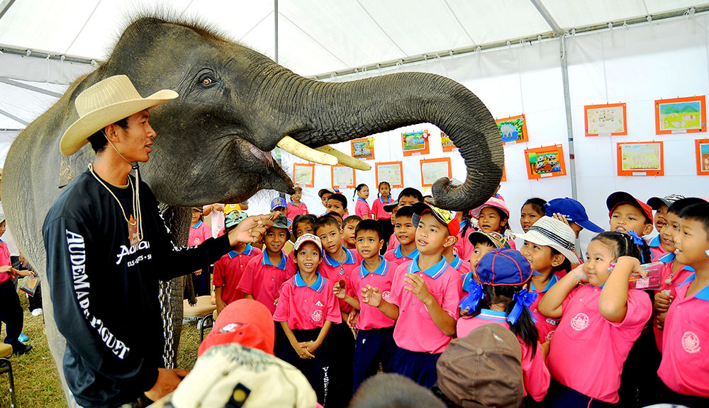 Children get up close and personal with their new jumbo friend.