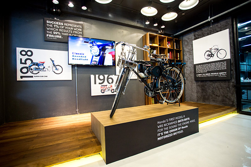 An exhibition on Honda's history with a prototype motorbike on display
