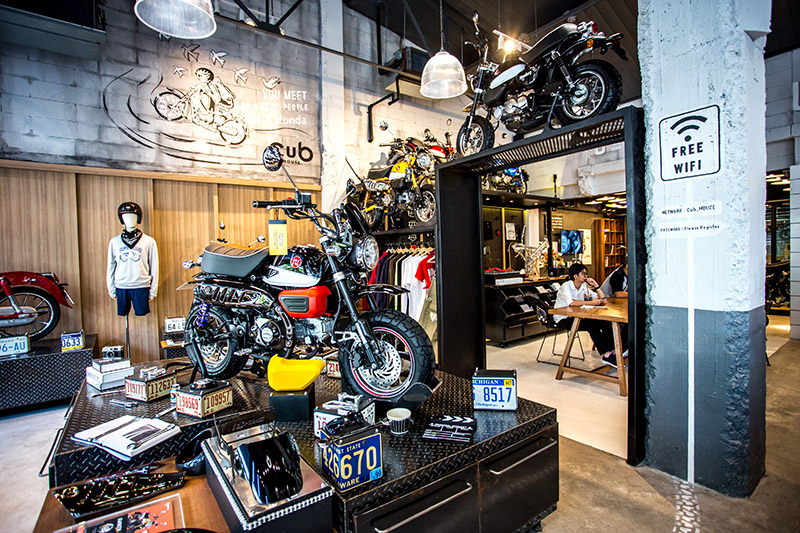 The cozy interior showcases several Monkey motorbikes