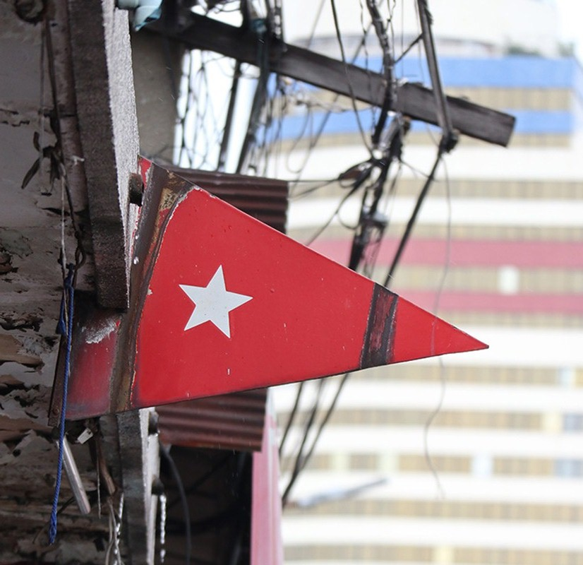 The last surviving colored metal flag in Chinatown from the heyday of tram system