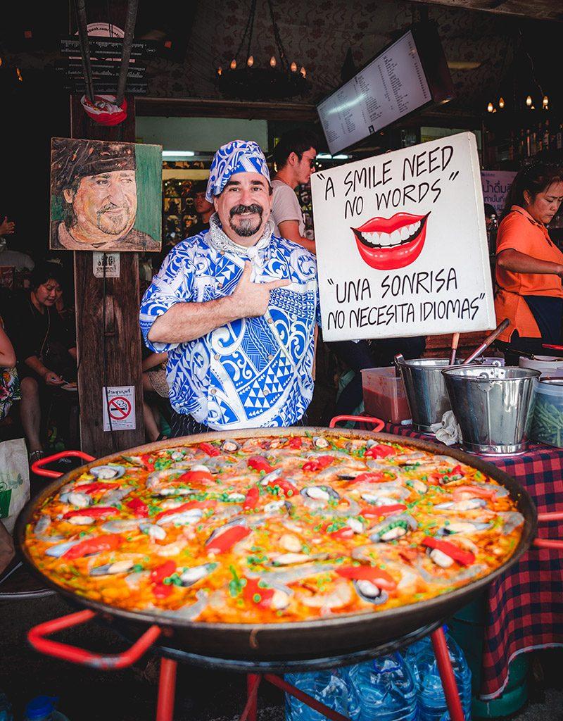 Viva 8 restaurant's eccentric Spanish Chef Fernando Andres Yusta poses near his seafood paella pan