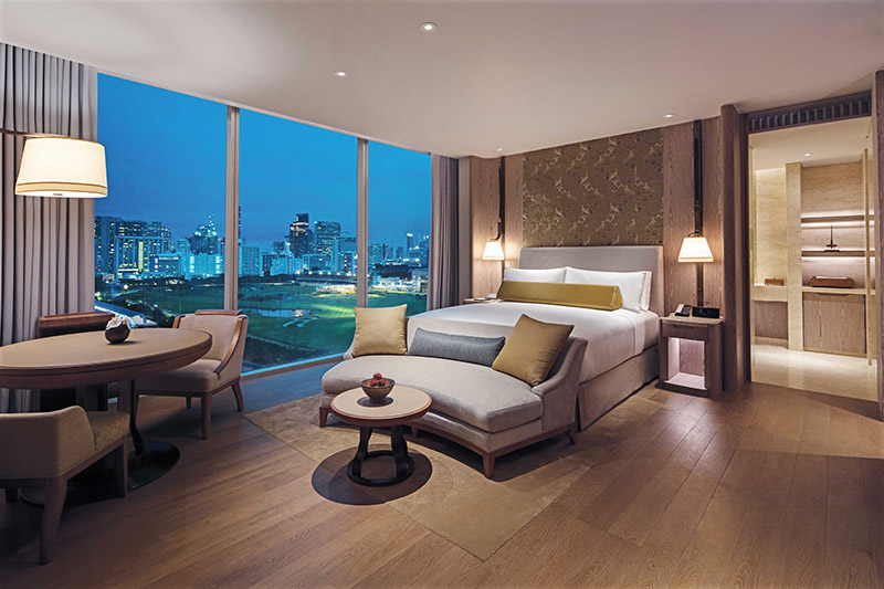 Luxurious and spacious guestrooms have stunning views of the city.