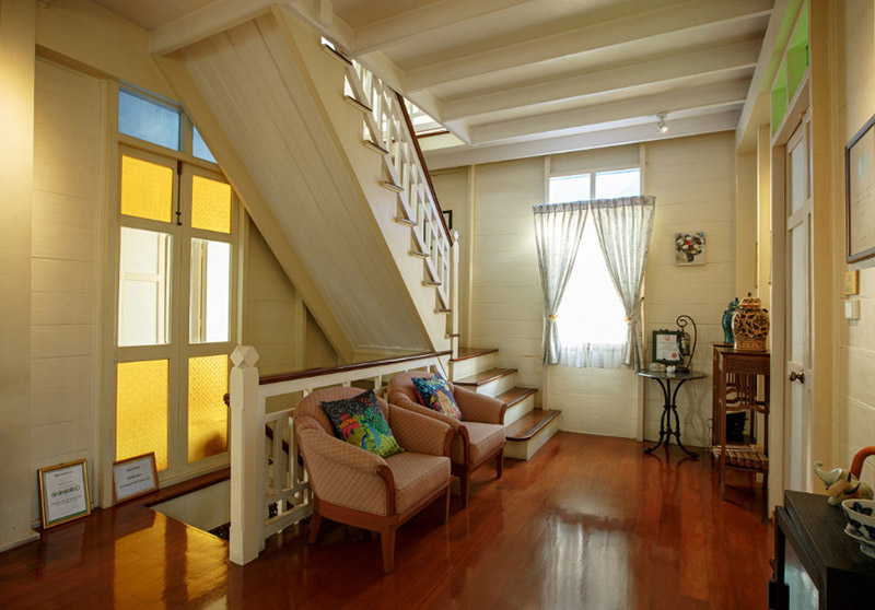 The interior is decorated with antique furniture on wooden floors.