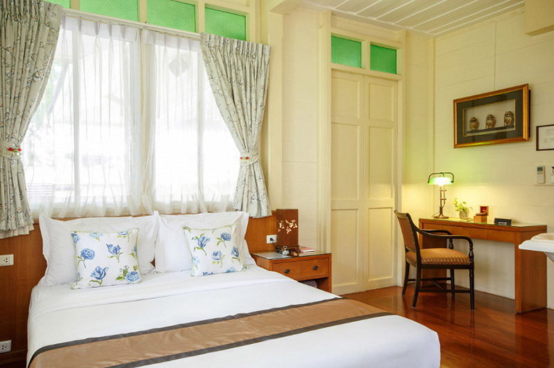 The deluxe room is spacious with a queen-size bed.