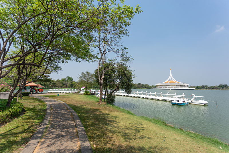 The Ratchamangkhala Pavilion fronted by a lake with swan pedal boats ready for rent.